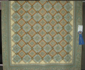 230B-Laurie McCracken-Elegance-1-1st Place Pieced, Single Quilt Maker